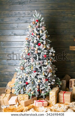 Decorated Christmas tree in red and white colors. Merry Christmas and Happy Ney Year! - stock photo