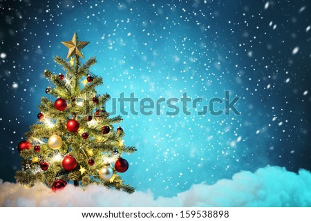 Decorated Christmas tree in snowy night,Concept. - stock photo
