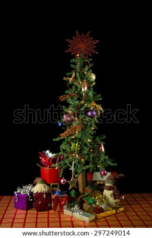 Decorated Christmas tree isolated on black background