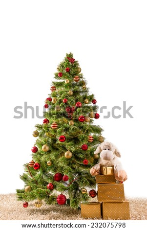 Decorated Christmas tree on a carpet with giftsand soft sheep toy  , card template