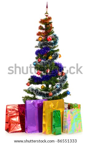 decorated christmas tree with gifts cut out from white background - stock photo