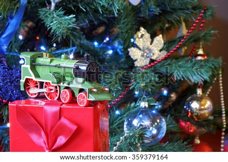 Decorated Christmas tree with train toy. Christmas tree and gifts. - stock photo