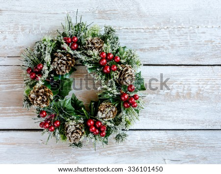 Decorated Christmas wreath on wooden background - stock photo