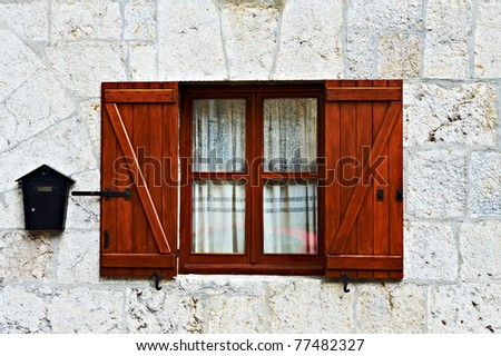 Decorated Closed Window and Postbox in Spanish Town - stock photo