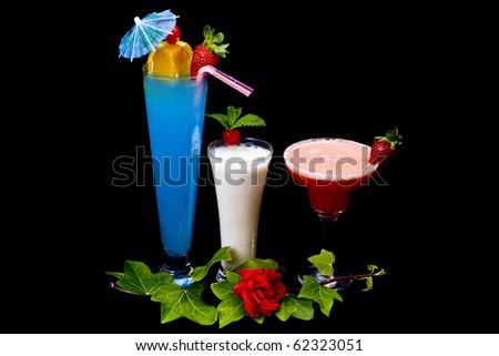 Decorated cocktails (Pina Colada, Strawberry Margarita and Blue Lagoon) over Black background. - stock photo
