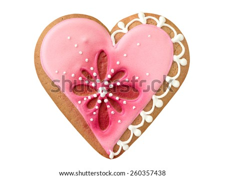Decorated cookie in the shape of heart on wooden table. Isolated, on white background. - stock photo