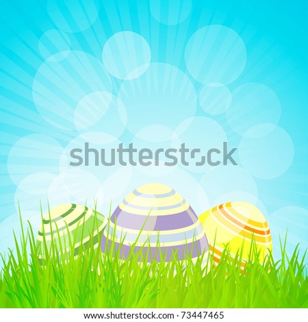decorated easter eggs in a spring landscape with sparkly blue sky - stock photo