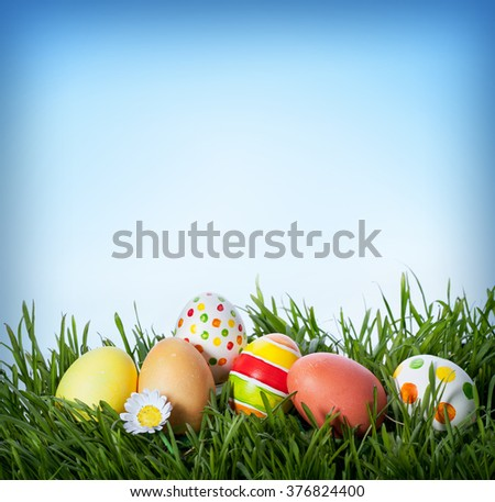 decorated easter eggs in the grass - stock photo
