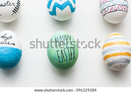decorated easter eggs on white background in nature light