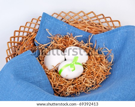 Decorated Easter wicker plate with eggs - stock photo