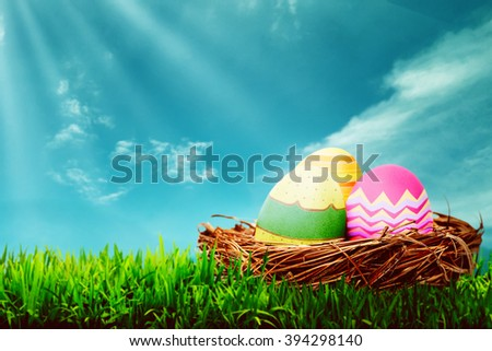 Decorated egg inside the nest. Happy easter concept
