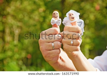 "decorated fingers on a wedding (soft focus on ""faces"""")"