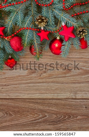 decorated fir tree border on wooden background, vertical shot
