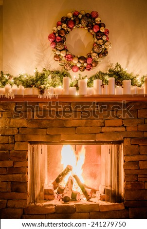 Decorated fireplace for christmas - stock photo