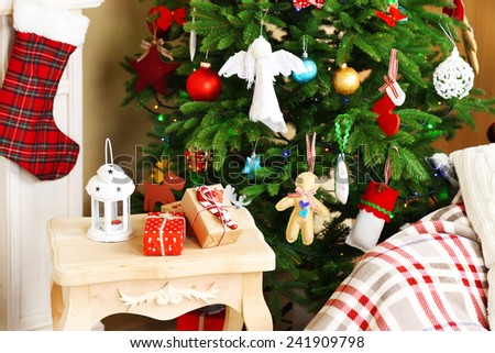 Decorated fireplace near Christmas tree. Christmas decoration concept - stock photo