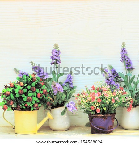 Decorated flower in garden with retro filter effect - stock photo