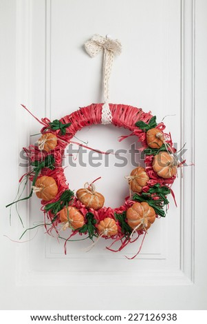 Decorated halloween twig wreath with little pumpkins - stock photo