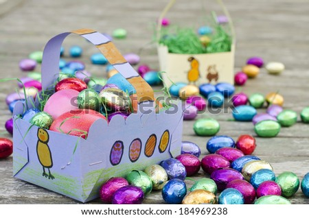 Decorated home made Easter baskets filled with chocolate eggs
