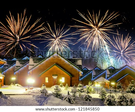 Decorated house with christmas lights and firework - stock photo
