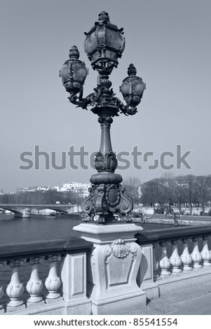 Decorated lamp on the bridge of Alexander III, in Paris. - stock photo