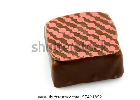 decorated luxury chocolate bonbon on a white background - stock photo