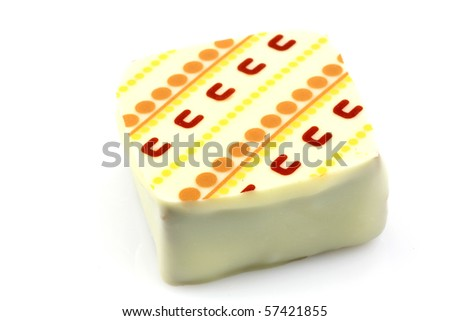 decorated luxury white chocolate bonbon on a white background - stock photo