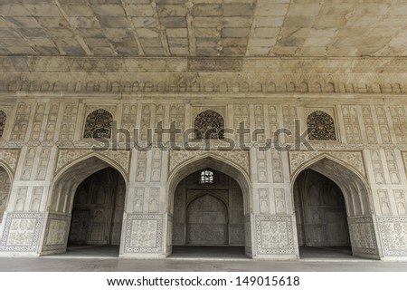 Decorated marble wall frames gate and door at Agra Fort Palace in India. - stock photo