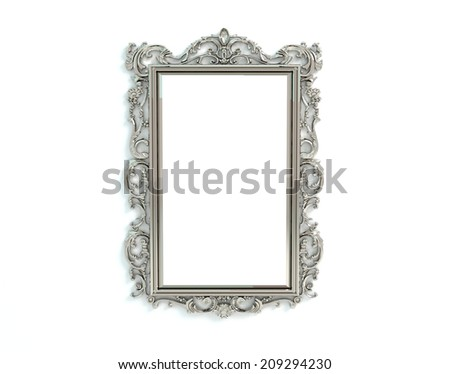 Decorated metal frame on a white painted wall. - stock photo