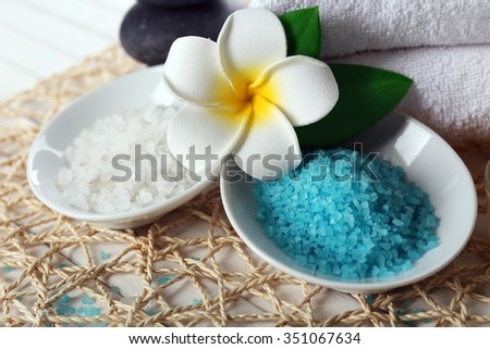 Decorated spa composition on wicker serviette - stock photo