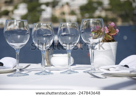 Decorated table in a restaurant outside-in the background Mediterranean sea