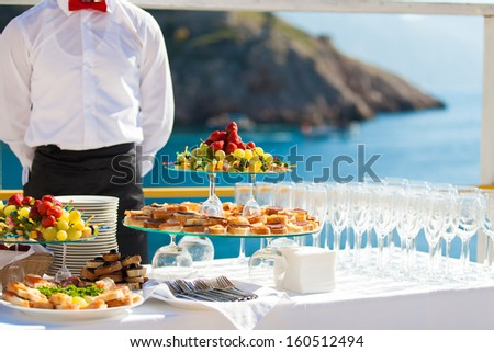 Decorated table reception at beach resort - stock photo