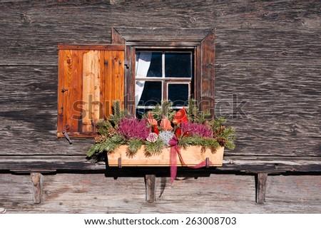Decorated traditional window of Swiss farm house