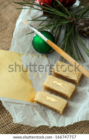 Decorated walnut cookies on paper