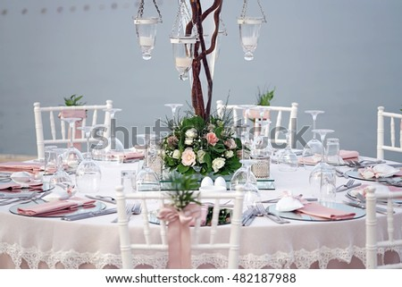 Decorated wedding table near the sea.