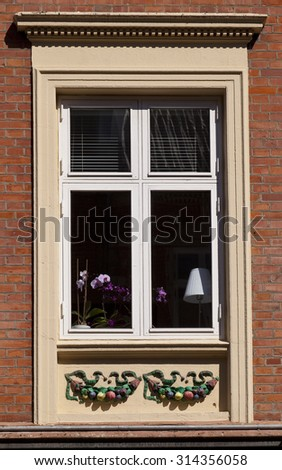 Decorated Window. Windows are important part of Danish culture. It is tradition to dress your windows with plants and sculptures so passers by can appreciate your taste.
