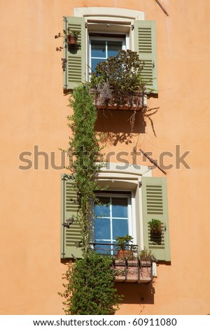 decorated windows in colored wall. South of France