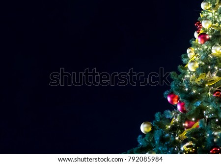 decorated with golden red balls Christmas tree festive tree on a background of a dark night sky with copy space, the foundation is a greeting card invitation