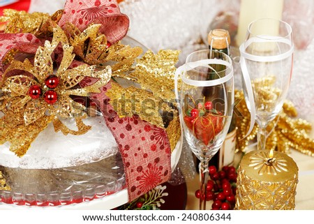 decorated xmas cake with a large variety of other items - stock photo