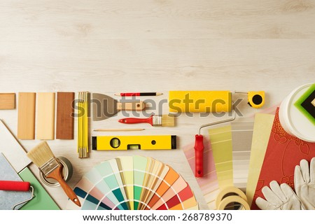 Decorating and DIY hobby tools and color swatches with copy space on top, top view - stock photo