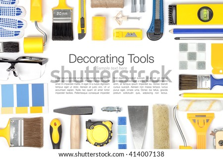 decorating and house renovation tools and accessories on white background. painter and decorator work table. flat lay frame composition in yellow and blue colors with copy space top view - stock photo