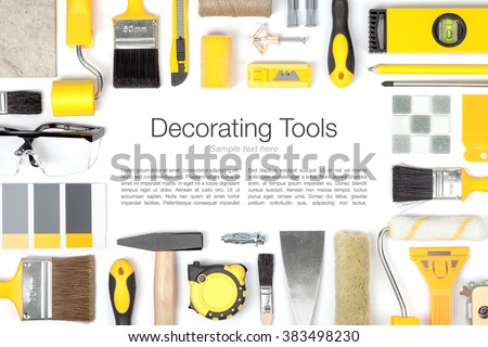 decorating and house renovation tools and other essentials on white background. flat lay frame composition in yellow colors with copy space - stock photo