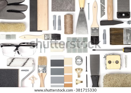 decorating and house renovation tools and other essentials on white background top view. decorating flat lay concept - stock photo