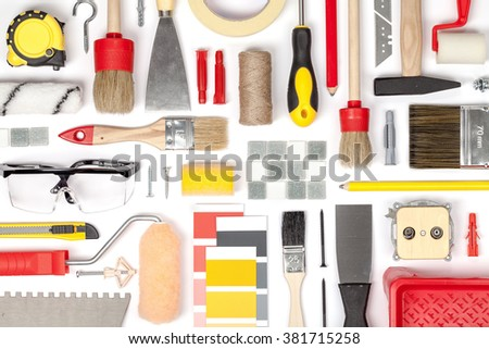 decorating and house renovation tools and other essentials on white background top view. flat lay composition in red and yellow colors