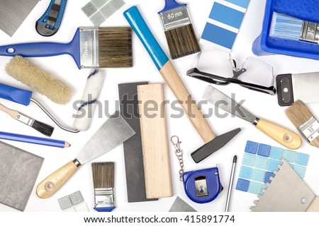 decorating and house renovation tools on white background. painter and decorator working table. creative mess composition top view - stock photo