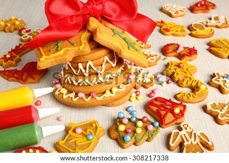 Decorating Christmas gingerbread cookies - stock photo
