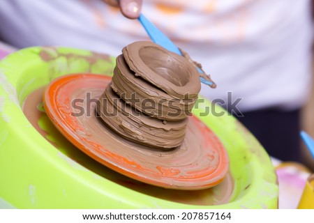 decorating clay pottery - stock photo