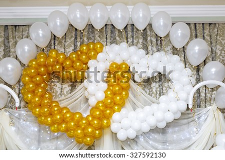 Decorating for a the wedding of balloons in the shape of hearts