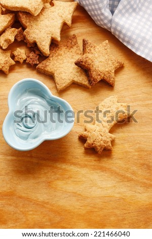Decorating gingerbread cookies with blue and white icing. Steps of making biscuits