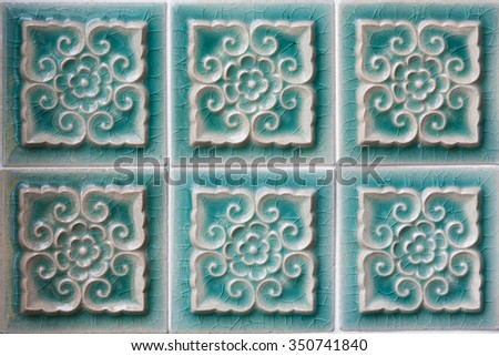 Decorating green ceramic wall tiles with leafs pattern. - stock photo