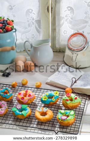 Decorating sweet and tasty donuts - stock photo